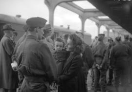 [Troops saying farewell to girls on platform of C.N.R. station]