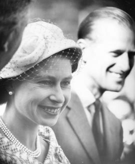 [H.R.H. Queen Elizabeth and H.R.H. The Prince Philip Duke of Edinburgh watch the entertainment at...