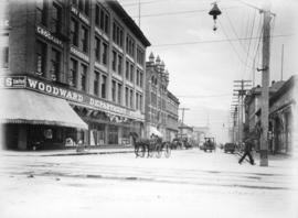 [Abbott Street at Hastings Street, showing corner of Woodward Department Stores building]