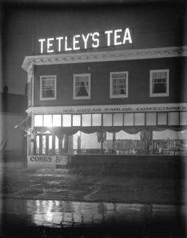 [Illuminated Tetley's Tea sign over ice cream parlour and tea room]