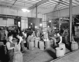 Vancouver Brewery [interior view - men crating bottles of beer]