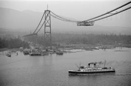[A Union steamship passing under the Lions Gate Bridge under construction]
