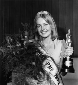 Brenda Hinds, Miss P.N.E. 1974, posing with flowers and trophy