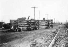 [People exploring the remains of a  freight car near the south end of Main Street after a collisi...