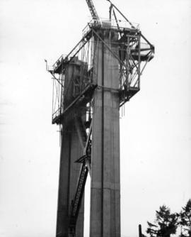 """Creeper"" is shown in position for erection of the top (and last) section of South towe..."