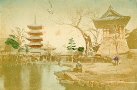 [View of garden area with pagodas and people sitting by a pond]