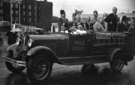 "[Group of shriners from Seattle, Washington in a ""Nile patrol"" truck at a Shriner parad..."