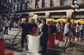 """Giant Fire Drill"" participants at water filling station"