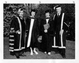 Susan MacKenzie and Mary Lett with their fathers at University of British Columbia graduation