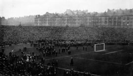 [View of a huge crowd at a sports field]