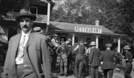 [Men in front of Bowen Island store and restaurant]