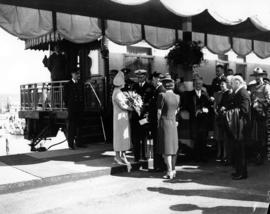 [King George VI and Queen Elizabeth prior to departure by train]