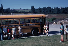 Children and school bus at Jericho Grounds, with West Point Grey Academy in background