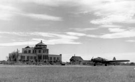 [Airport administration building and airplane]