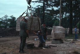 Adolf Ryszka's stone being put in place at VanDusen [Botanical Garden] by Canadian Forces