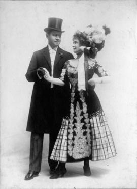 [Unidentified man in top hat with woman in gay nineties costume]