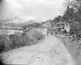 [Road and buildings beside] waterfront at Pacific Mills [on the] Queen Charlotte Islands