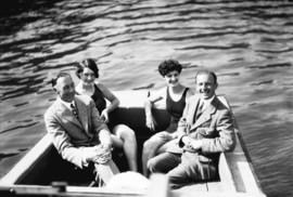 [Four people on boat, women possibly Queenie and Maisie Lyons]