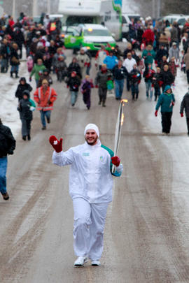 Day 48 Torchbearer 29 Ryan Albright carries the flame in curve Lake, Ontario.