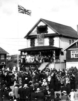 "Raising the British flag at ""Khaki Home"" [for the South Vancouver Red Cross Society]"