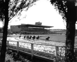 Horse race on Exhibition Park race track with Grandstand in background