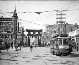 [View of Hastings Street, looking west from Cambie Street, showing Japanese arch and other decora...
