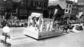 [The Native Sons and Daughters of Canada float in the Dominion Day Parade]