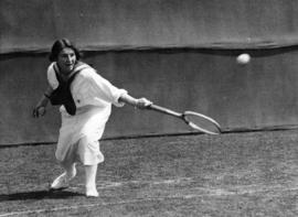 [A woman playing tennis]