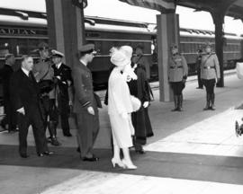 [King George VI and Queen Elizabeth arriving at C.P.R. Station]
