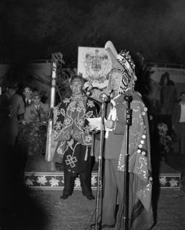 [Lord Alexander in full First Nations dress making a speech at the ceremony making him an honoura...