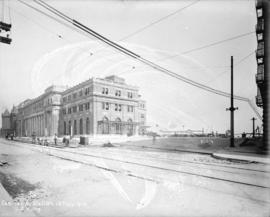 [Men laying streetcar tracks in front of second C.P.R. station]