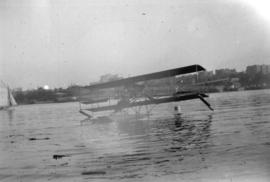 [William Stark in plane fitted with pontoons on Coal Harbour]