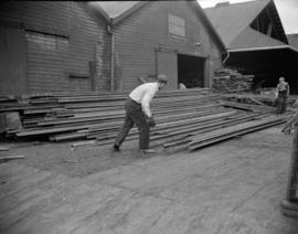 [Men moving pieces of steel at Evans, Coleman, and Evans, Ltd.]