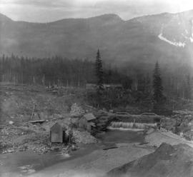 Coquitlam Dam [showing] overflow from spillway of original dam