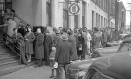 [People lined up in front of the Government Liquor Store on Beatty Street]