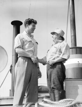 Dick Jack, Assistant Product Manager Canadian Fishing Company congratulates Skipper Joe [Cerezin]...