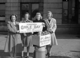 [Women promoting Kinsmen Apple Day to help babies in Britain]