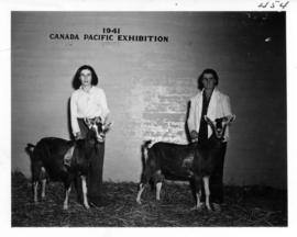 Women with prize-winning goats in Livestock building