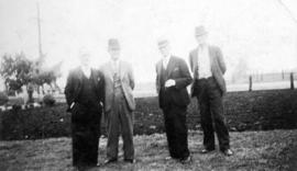 [L.D. Taylor standing with three men]