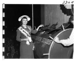 Miss P.N.E., Joan Greenwood, drawing ticket for P.N.E. Program prize drawing on Outdoor Theatre s...