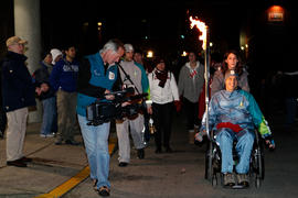 Torchbearer 29 Brian Bell carries the flame with cameraman Pat Bell in Maple Ridge, BC