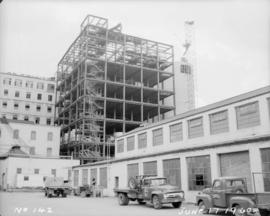 Construction of pan house: exterior view, roof started