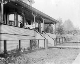 [Group portrait of the Charles Gross family on the verandah of residence - 83 Chesterfield Avenue]