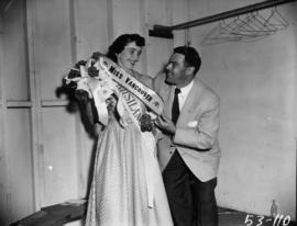 Man posing with Miss Vancouver