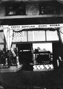 [Front window of photograph supply and stationery store] 900 block of Granville Street