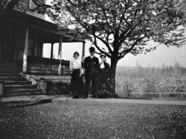 [Miss Mary Maddams with Mr. and Mrs. C.C. Maddams in front of Maddams Ranch at 941 East 7th Avenue]