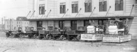 [Champion & White Ltd. fleet of trucks at CN Station with floats promoting Robin Hood Boilers...