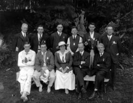 Music dealers picnic, group portrait of male officials with woman in centre