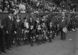 [Group in Scottish attire at Caledonian Games, Athletic Park]