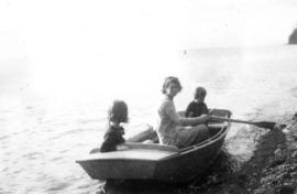 Jane Banfield, Beatrice Timmins and John Banfield in boat at beach